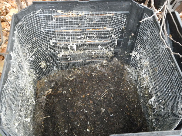 Composter lined with hardware screen to discourage foraging by vertebrates.
