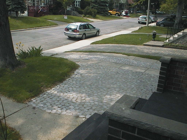 The new driveway (widening and middle section of main drag) with pavers replacing lawn and concrete slabs, respectively.
